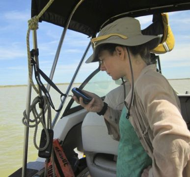 "Katie Collucio, recipient of a UC PhD Scholarship taking field measurements on Te Waihora/Lake Ellesmere"" Photo: Luke Jeffrey"