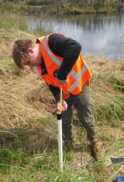 Masters in Engineering Geology student using a mini piezometer in the field. Photo: Leanne Morgan